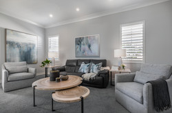 Modern living room in greys and neutral wood tones