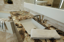 Master bath with beige and brown granite countertops
