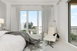 Neutral master bedroom with a view