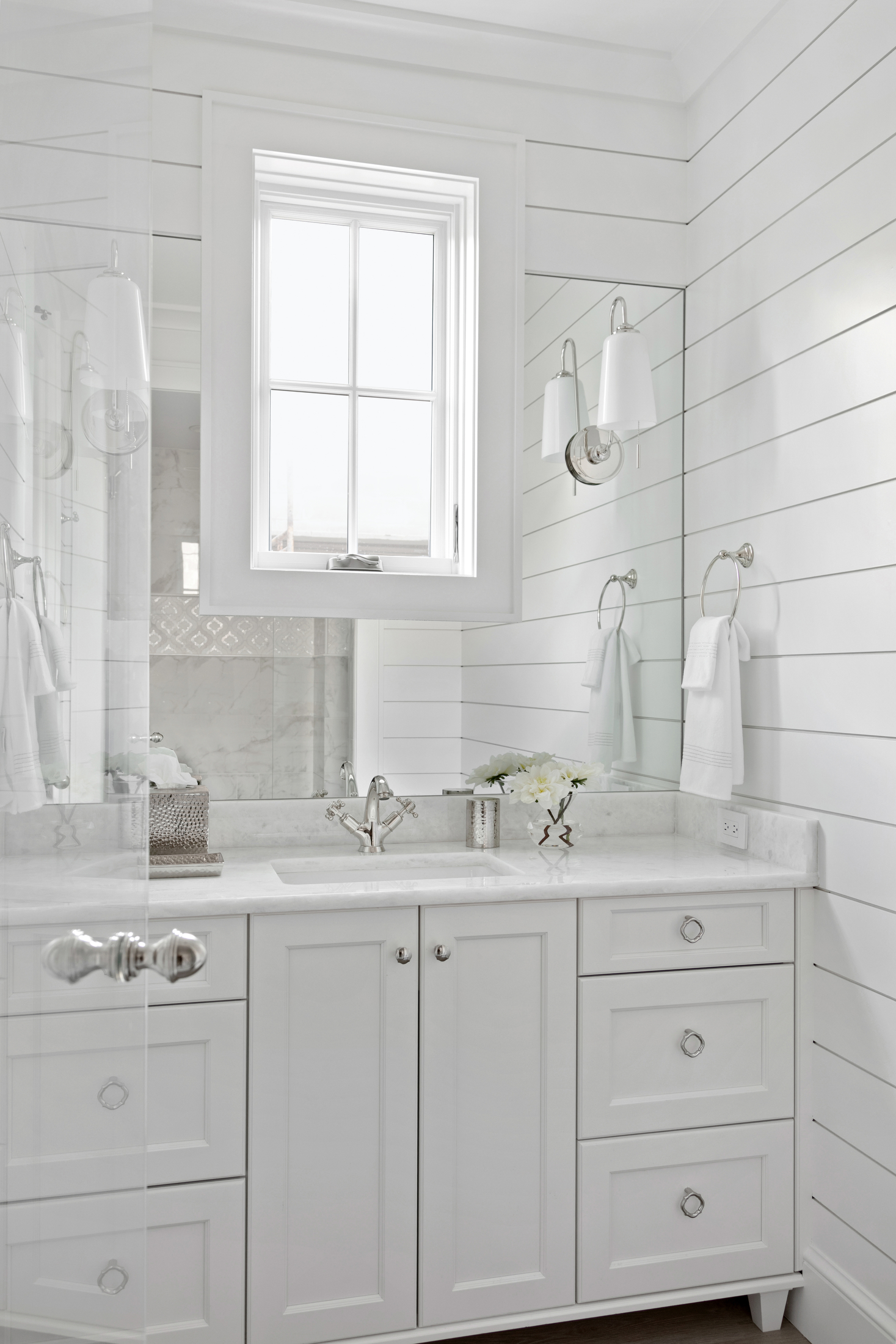 All white bathroom with coastal elements