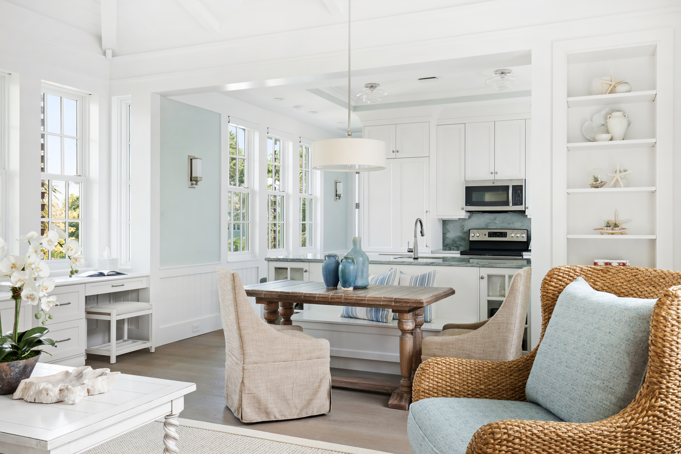 Open kitchen and living room with coastal accents