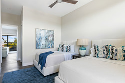 Modern luxury guest bedroom in blue and white tones