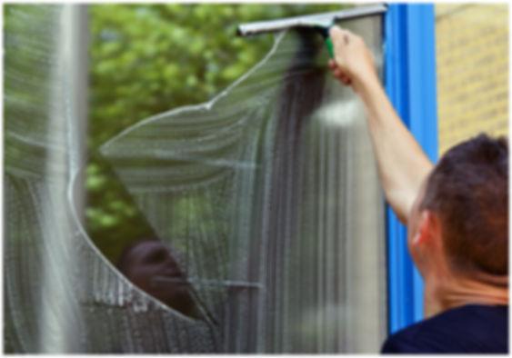Man cleaning window using Window Cleanin