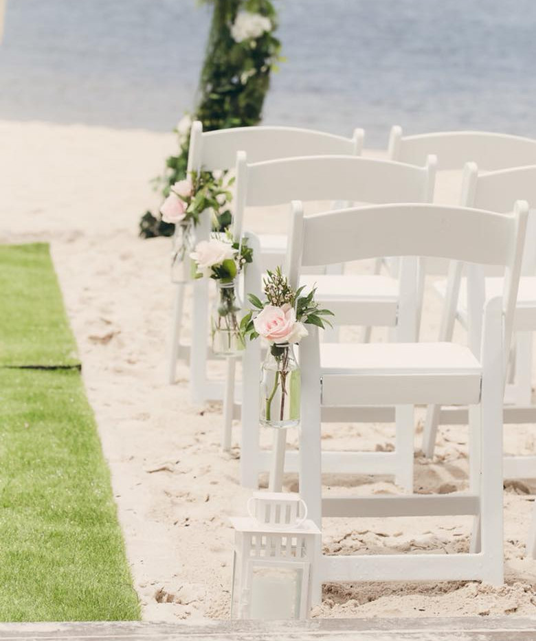 wedding flowers on chairs sunshine cost