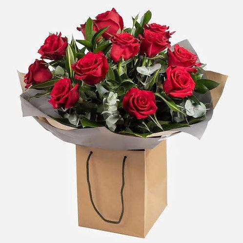 Roses displayed in gift bag