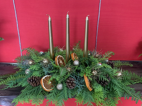 Christmas table arrangement with 3 candles