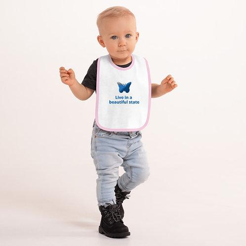 Babero de bebé con bordado
