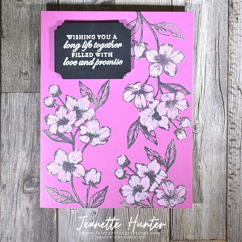 Image of handmade card using Stampin' Up! products.  Features the Forever Blossoms stamp set and the Tasteful Labels dies. Done in Basic Black and Magenta Madness colors.