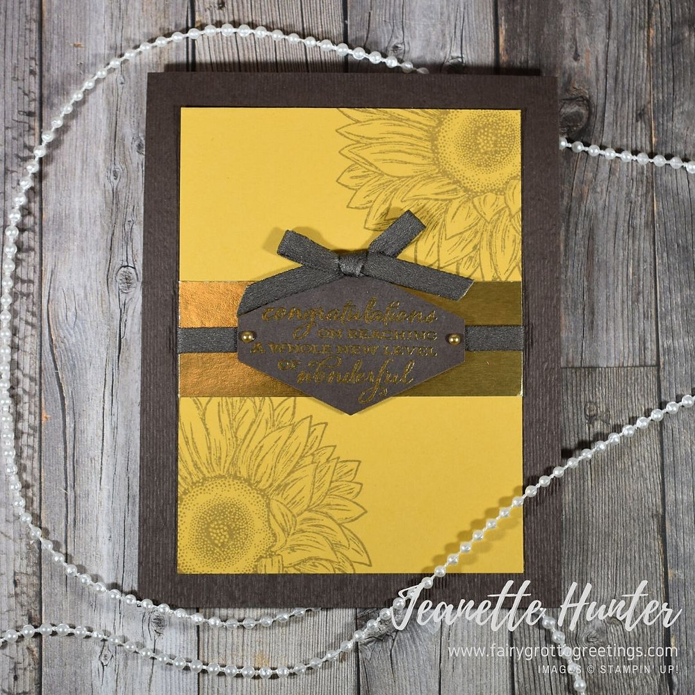 Image of handmade card using Stampin' Up! Products.  Features the Celebrate Sunflowers stamp set as well as the Tailored Tag punch. Done in Early Espresso, Bumblebee and Gold (foil) colors.