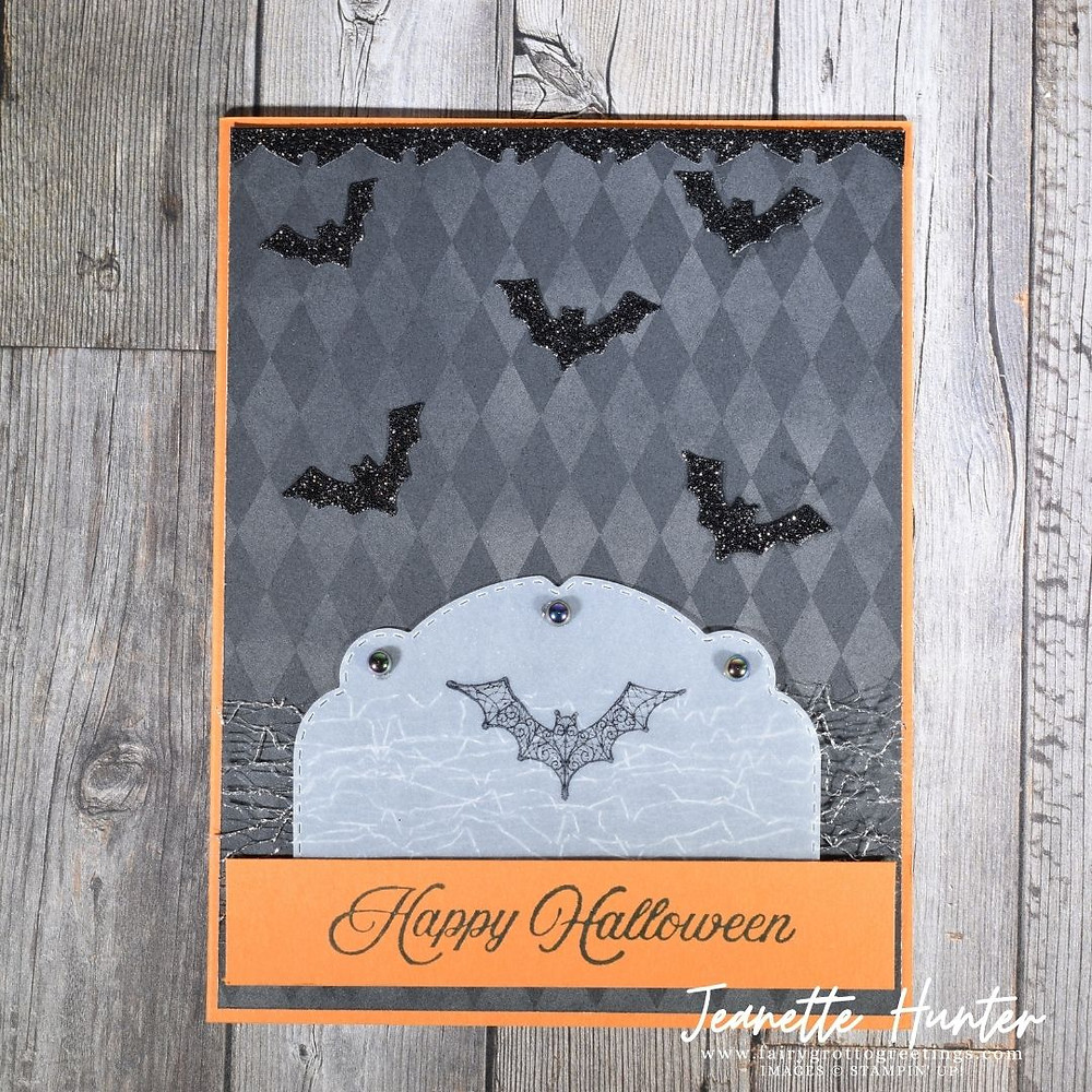 Image of handmade card using Stampin' Up! products.  Features the Magic in this Night suite. Done in Basic Black, Pumpkin Pie, Vellum and Black Glitter Paper.