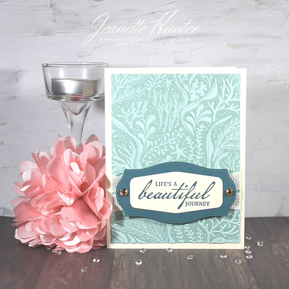 Image of handmade card using Stampin' Up! products.  Features the Beautiful World stamp set and Tasteful Labels dies. Done in Pretty Peacock, Pool Party and Very Vanilla.