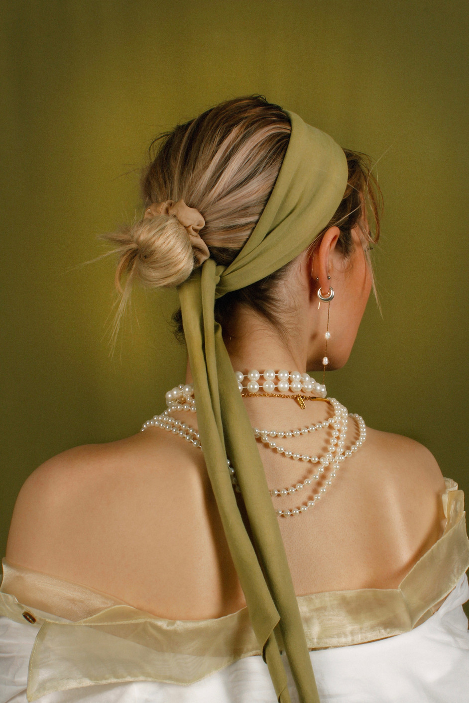 The Girl With The Pearls