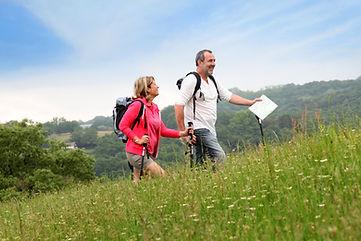 Senior couple hiking in natural landscap