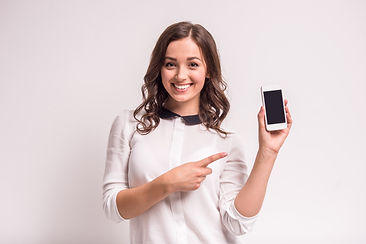 Smiling woman is pointing on smartphone