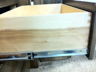 Dove tailed drawer with metal guides.