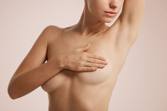 naked-woman-covering-herself.jpg
