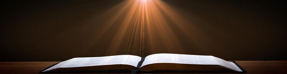 Bible open light rays.jpg
