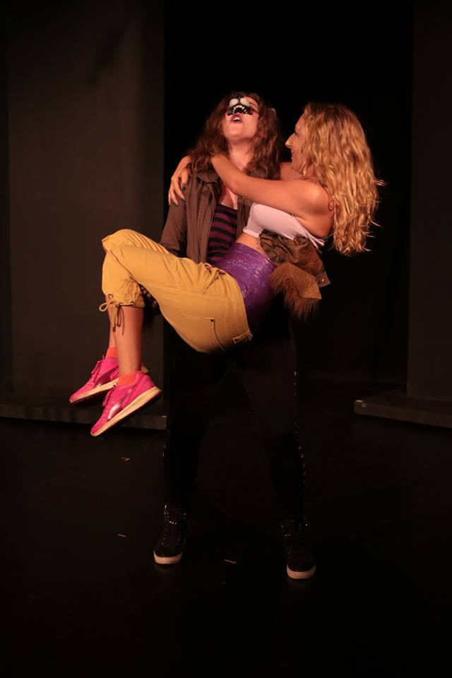 Kelsey, dressed as Wolfman, scoops up her team mate in a dashing show of romance and alpha male coolness.