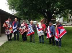 Veterans with their donated quilts