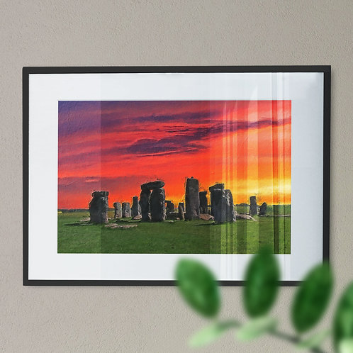 A Wall Art Print of Stone Henge at Night with Red and Yellow Sky