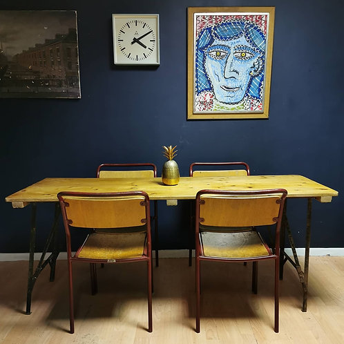 Folding trestle table and four stacking chairs by Steel style Co. Durham