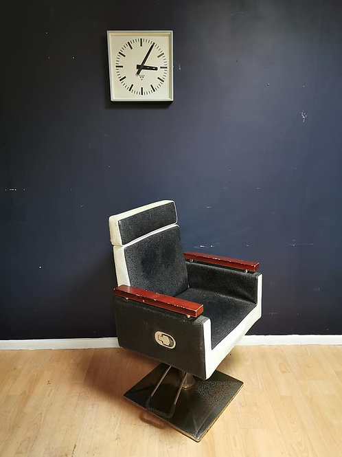Monochrome vinyl reclining barbers chair