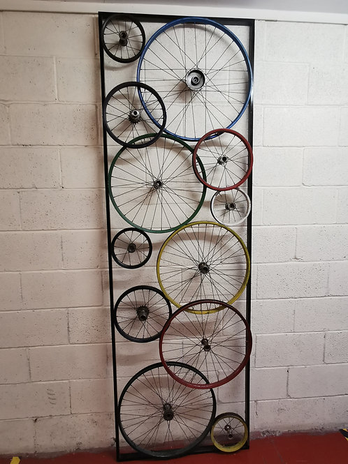 Painted bicycle wheel divider/wall art