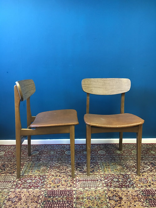 Pair of Formica chairs with brown vinyl