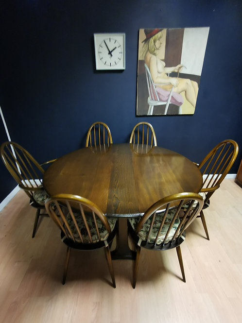 Ercol 610 Gate leg dining table with six Ercol 365 quaker dining chairs