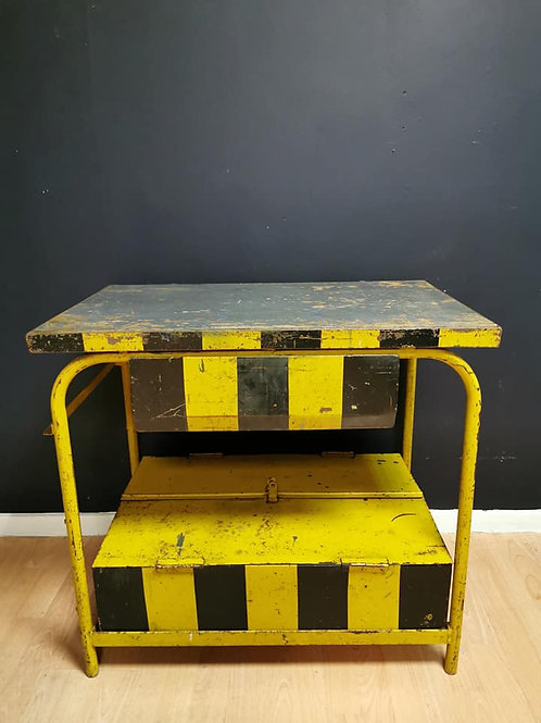 Yellow and black striped industrial workbench table
