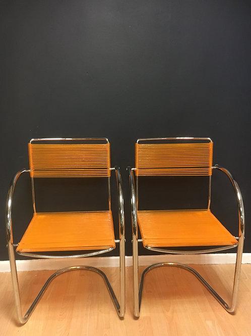 Two Chrome & Orange Pvc 'Spaghetti' chairs
