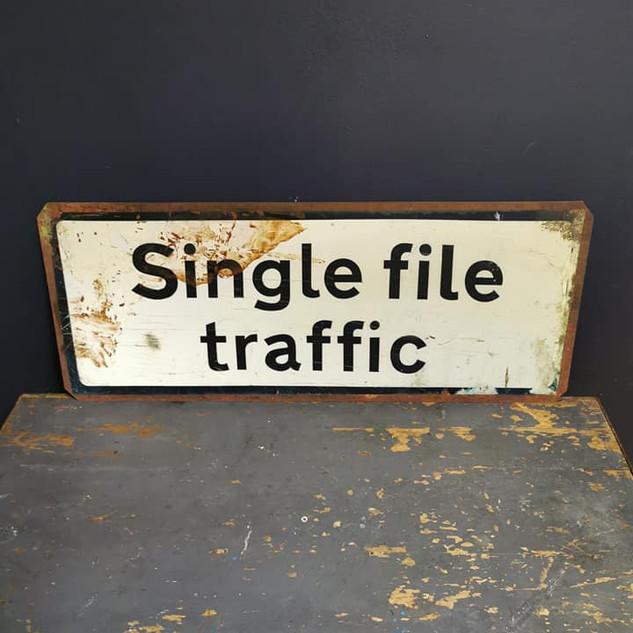 Single file road sign