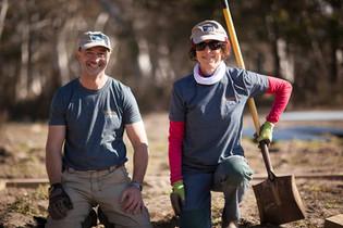 Volunteers building chook sheds