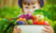 Child and vegetables. Selective focus. .