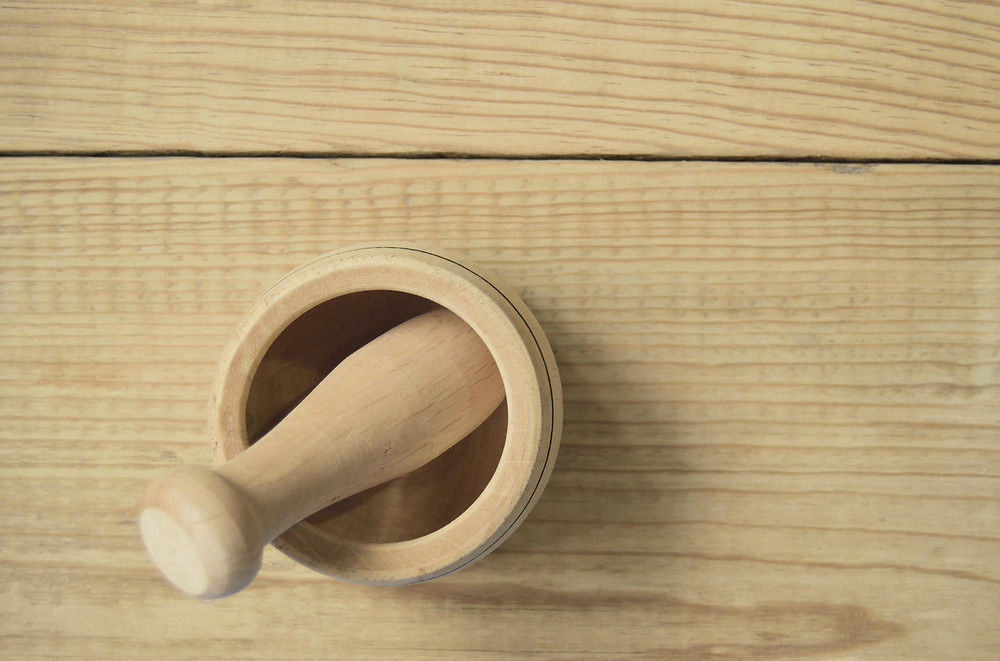 Wooden pestle and mortar for grinding food in your kitchen