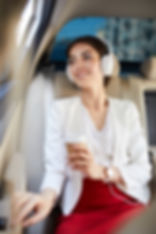 Portrait of young businesswoman listenin