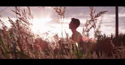 Josh in grass. PP. Timeline.00_06_49_11.Still001