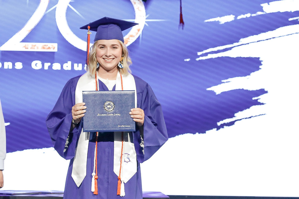 High School female graduating. Posing with certificate.