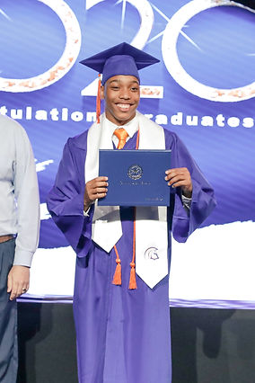 High School male graduating, posing with certificate.