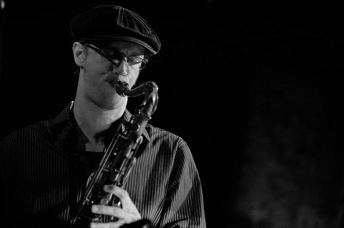 Chris West playing saxophone