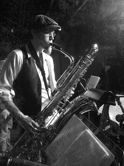 chris playing baritone saxophone (bari sax)