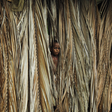 Child in floating village - Papua New Guinea