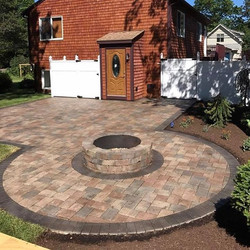 Added sealer to this patio and fire pit 🔥 I did last year. It looks great.jpg