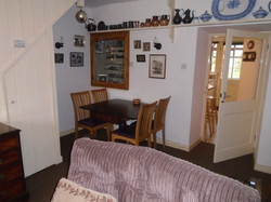 Dining area with door to kitchen and con