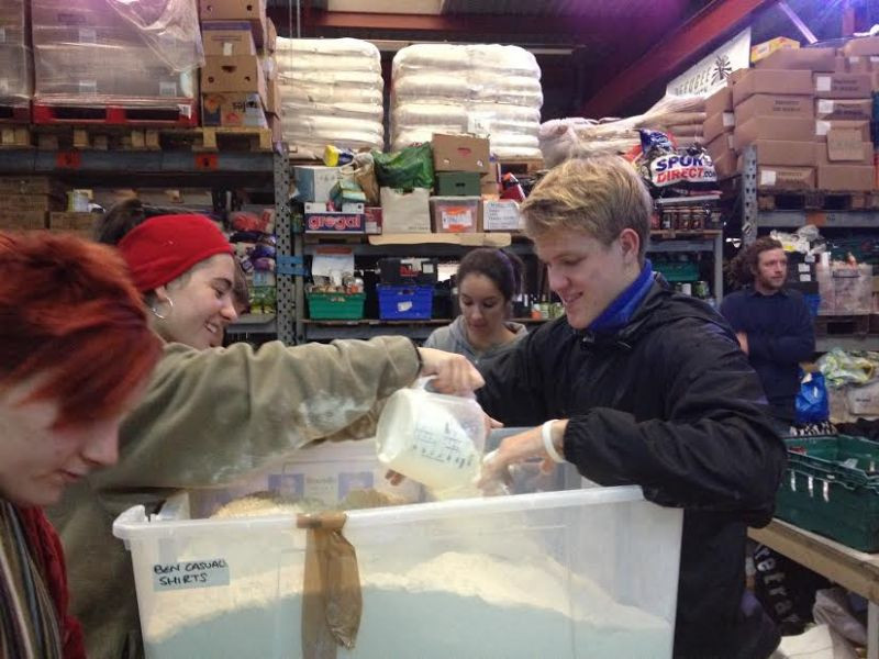 Edith and Matthew seen here bagging flour for the Jungle residents.