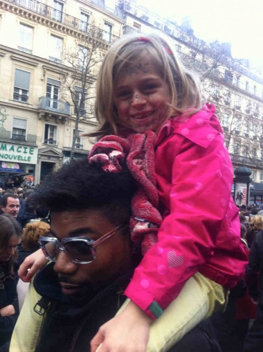 The six-year-old daughter of Parisian Gaelle Heyert with 'I am Charlie' written on her face.