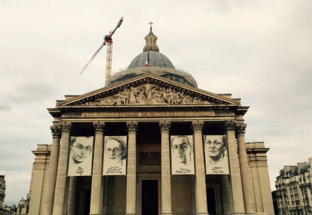 Artistic impressions of the four French Resistance fighters, including two women, interred at The Pantheon last Thursday hang majestically over its entrance. ― Picture by Helen Hickey