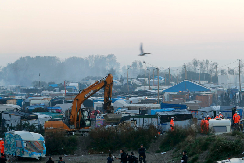 A bulldozer is used to remove debris as workmen tear down makeshift shelters during the dismantlement of the camp called the 'Jungle' in Calais, France, October 27, 2016. — Reuters pic.