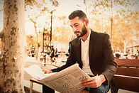 Man reading FAHASS newsletter