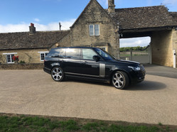 Range Rover Chauffeur Hire - Outside a Country Farm House